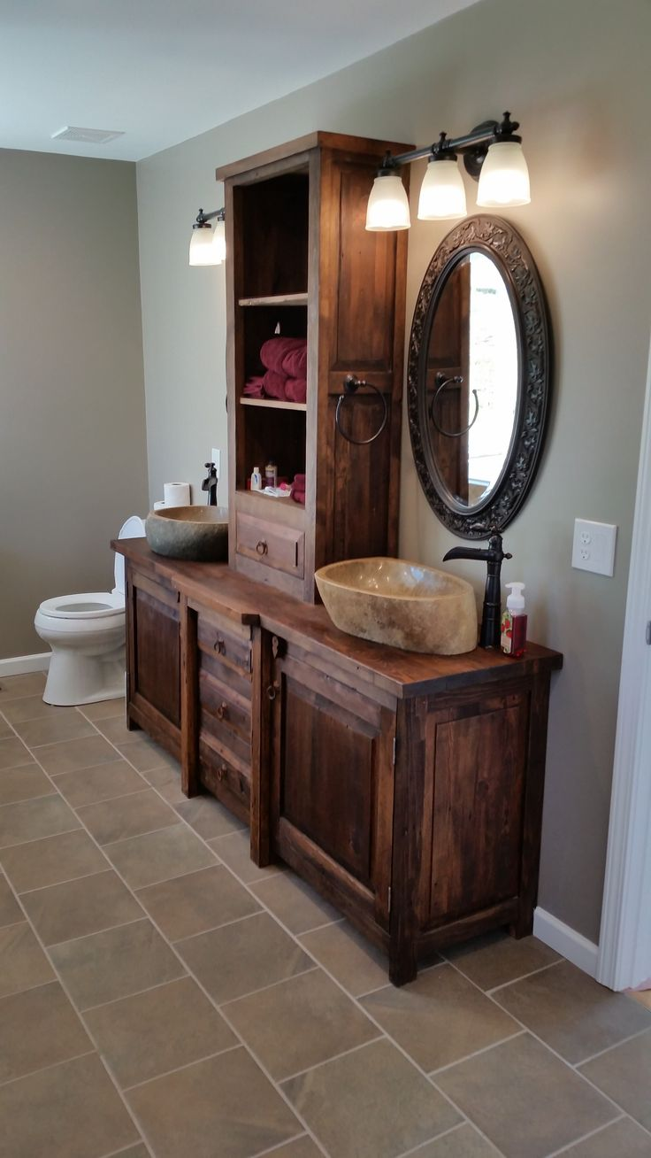 Love this type of vanity for master bathroom. Not sure I like the sink vessels.
