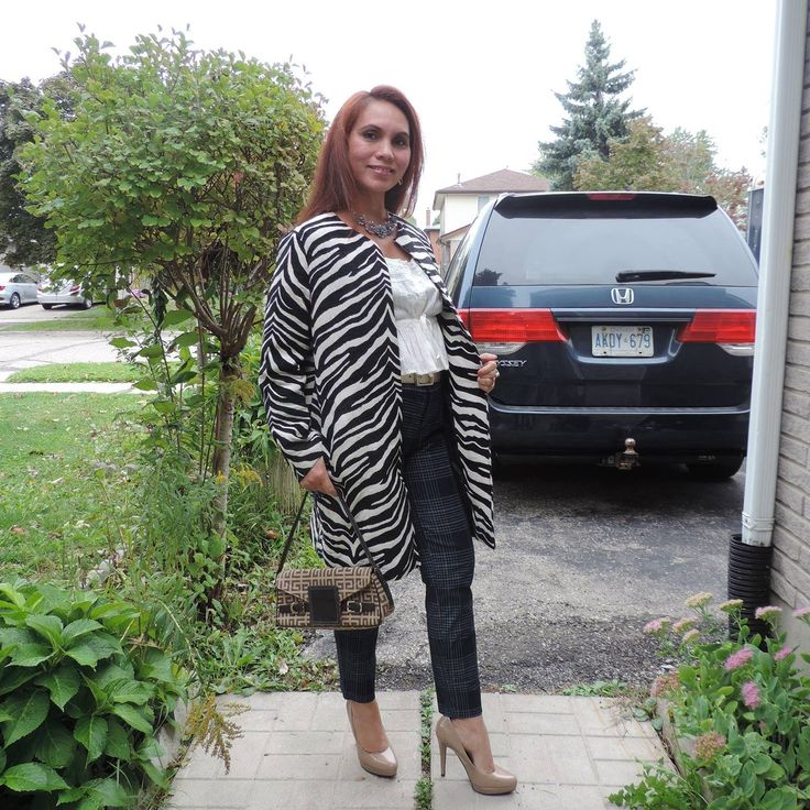 Zebra print blazer with navy stripe trouser.