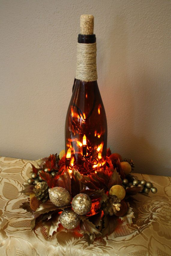Lighted brown upcycled wine bottle with decorative