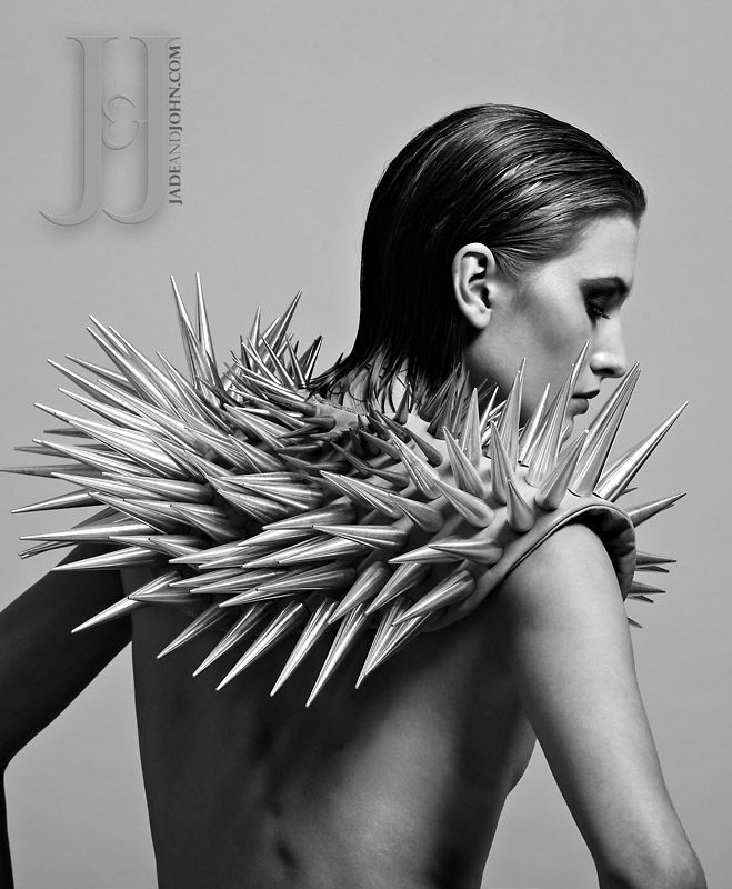 "Make a statement in this extreme metal spiked shoulder piece from Jade and John. This piece speaks for itself.  Three different sized brass & aluminium spikes tower up from the boned leather base.  2"" spikes are brass, 3"" and 4"" spikes are aluminium.  Leather base is a tan colour - pinned by RokStarroad.com ~ unleash your inner RokStar - fashion, pop and mental health"