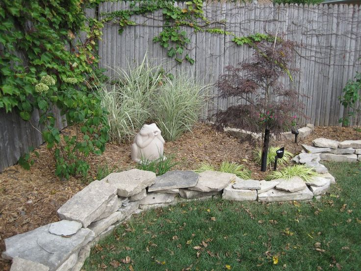 rocks around the mulch to define the area landscaping yard