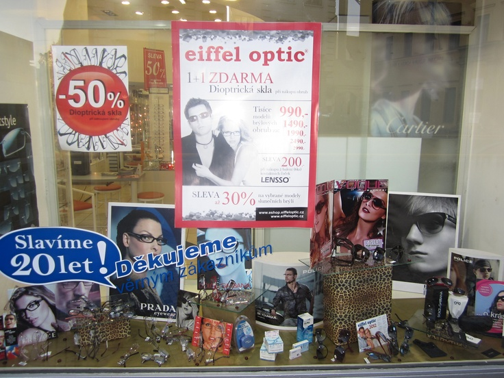 Eiffel Optic's windows once again reaching their low, low standard. 3 promos are, of course, better than one. Look a little closer to find the Cartier eyewear - sold only in the very best shops.