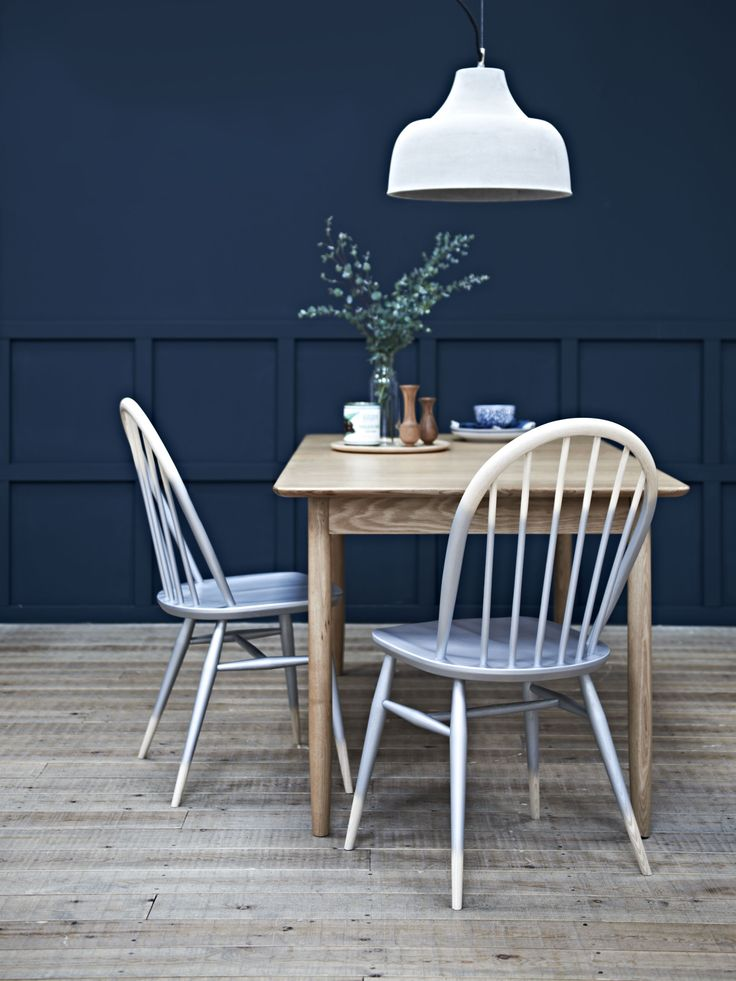Set the table for a relaxed dinner with family and friends. We love this Ercol mid century modern style dining table and painted chairs #barkerandstonehouse #diningroom