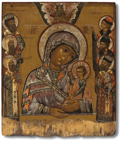 The Shuiskaya-Smolenskaya icon of the Mother of God is a waist-length depiction of the Mother of God holding the Child Jesus in her arms.The iconographic feature distinguishing the Shuiskaya icon from other Hodegetria variants is the characteristic position of the arms and legs of the Divine Child: the foot of his right leg stands on  the ankle of the left, with his left hand he supports his feet. In his right hand Christ is holding a folded scroll.