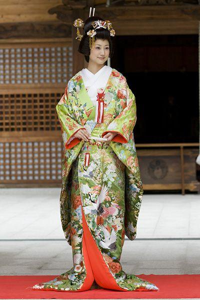 wedding kimono with uchikake- upper garment. traditional Japanese wedding hairstyle. Shinto wedding