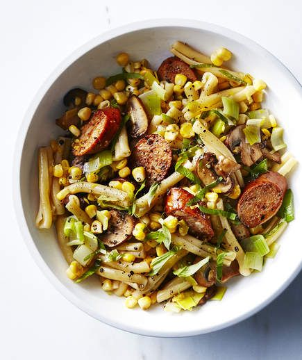 "Pasta With Chicken Sausage, Corn, Leeks, and Mushrooms | Nothing's better than a pasta you can whip up from ingredients you already have lying around. Ready in minutes, these ""back-pocket pastas"" are the best in our books. This recipe could easily become a go-to. It has a super short ingredient list because Italian chicken sausage adds a ton of savory flavor and spices. Plus it's pre-cooked so you just need to heat it up. Find pre-cooked sausages near the bacon at your grocery store. Any…"
