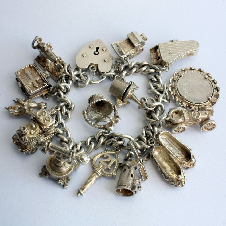 Antique Charm Bracelet.... I Would Change Some of These and Make Some Necklaces and Leave The Rest!