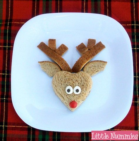 Gunther the Reindeer Sandwich from Holiday Food for Kids from Little Nummies.  Love the utilization of the crust for antlers.  Use heart shape cookie cutter for the face, mini marshmallows, mini chocolate chips & a red M for Rudolph nose.