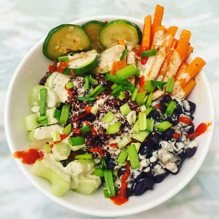 Quinoa buddha bowl with turmeric carrots, black beans, zucchini and hempseed miso tahini dressing