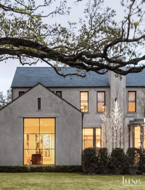 Smooth troweled cement plaster and a slate roof define the exterior.