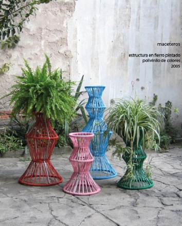 Plant pots by Cecilia León de la Barra  I love the colours and flagstones
