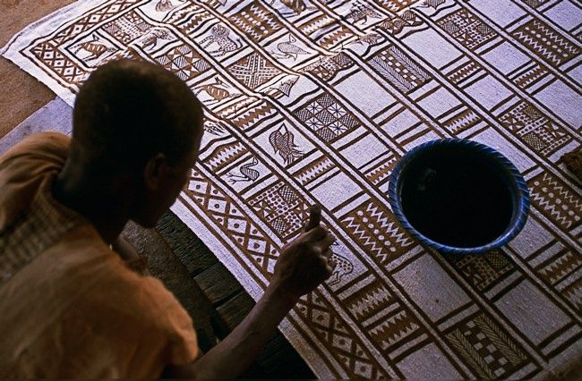 Africa | Making mudcloth textiles in Korhogo.  Senufo people of the Ivory Coast | ©Michel Renaudeau