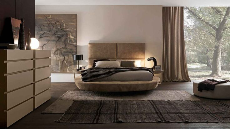 """Zero size small bed with Bold h. 1360 headboard in camel coloured """"aged"""" leather with matt corda lacquered Point coffee table with swivel drawer. The asymmetric versions are available right or left hand. Also Zero Bed can be in 2 -position lift-up storage base version."""