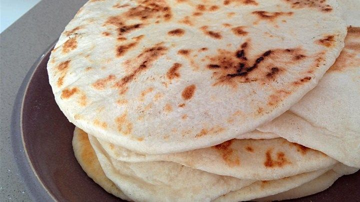 Pita Bread - Mix up a simple dough, let it rise, and experience the true taste of homemade pita breads from your own kitchen.