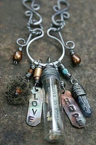 A cute necklace with a ton of things hanging from it