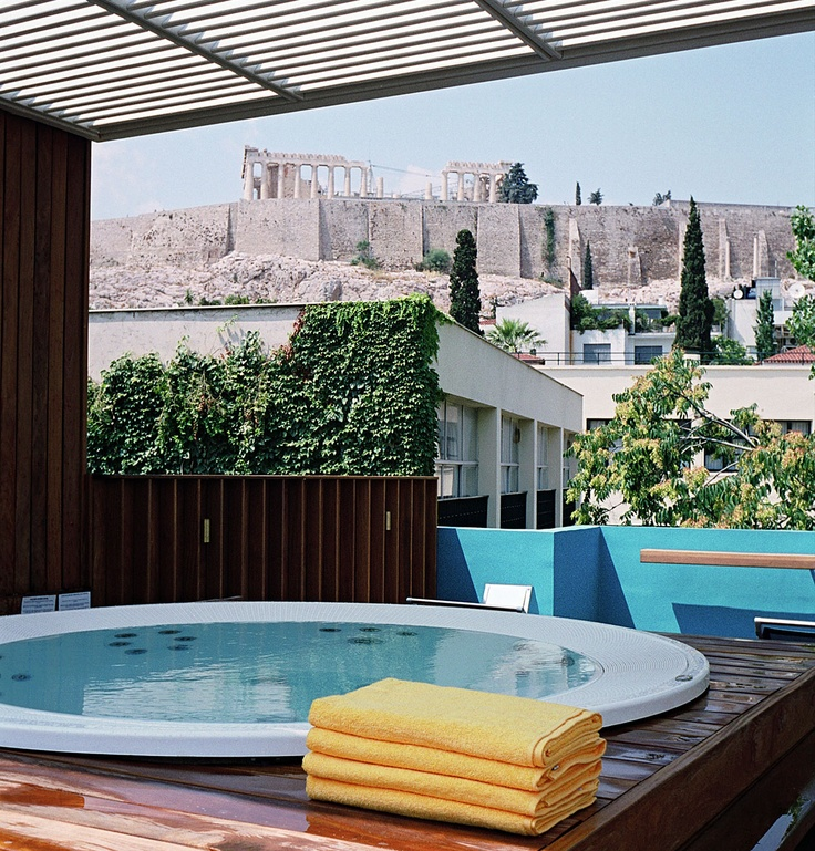 What a way to hot tub! Experience the Athenian sky, the Acropolis hill, the Parthenon and the Museum exhibits from the top floor of the Herodion Hotel in Athens, Greece