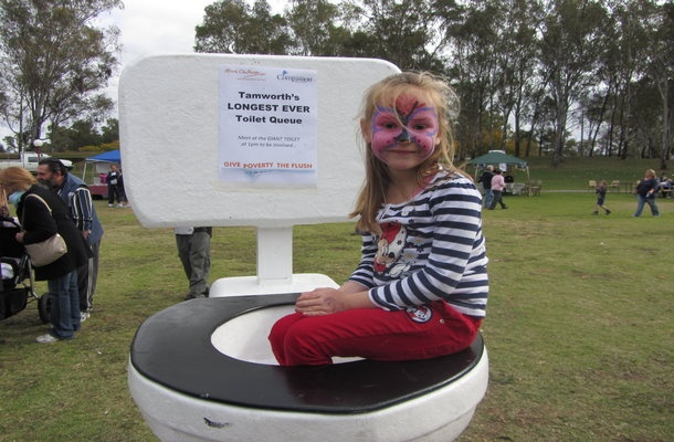 A little girl sits on the Giant Toilet at the toilet tour launch in Tamworth May 26.