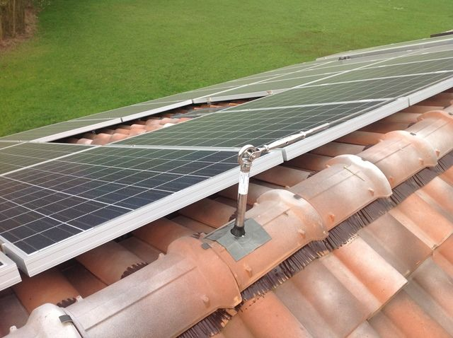 6 kW residential solar. In the front stage the life line to hook on during maintenance. Italy 2013
