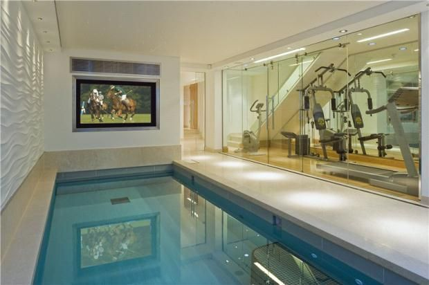 """Pool & gym - Arranged over 3 floors, this 6 bedroom house in Cadogan Place, Knightsbridge, London has been restored and refurbished with a classic, yet contemporary design, with many original features. It includes a Boffi kitchen, two guest cloakrooms, """"His and Hers"""" dressing rooms, ensuites for every bedroom, laundry room, swimming pool, four terraces, steam room, home cinema, lift and a staff suite. For sale with Savills for £28,000,000."""