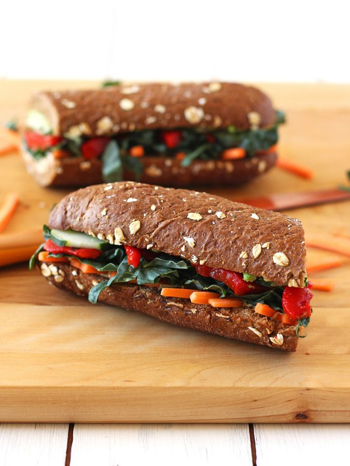 Roasted Red Pepper, Carrot and Hummus Sandwich.  Spice up your lunchtime routine with this high fiber, high protein vegetarian sandwich.  Filled to the brim with hummus, avocado, fire-roasted red peppers, kale, carrot sticks, cucumbers, spicy sriracha sauce and a sprinkle of red chili pepper flakes.