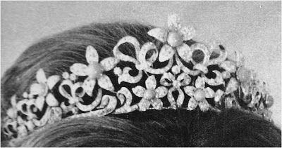 The Ogilvy Diamond Tiara - 1963 - by Collingwood - As a young princess, Princess Alexandra of Kent occasionally wore a set of diamond flowers in her hair.  Her new husband, the Hon. Angus Ogilvy, had the flowers made into a tiara. The tiara includes a series of those five petal diamond flowers, each one with an interchangeable stone in the center, set in a swirling diamond ribbon structure.