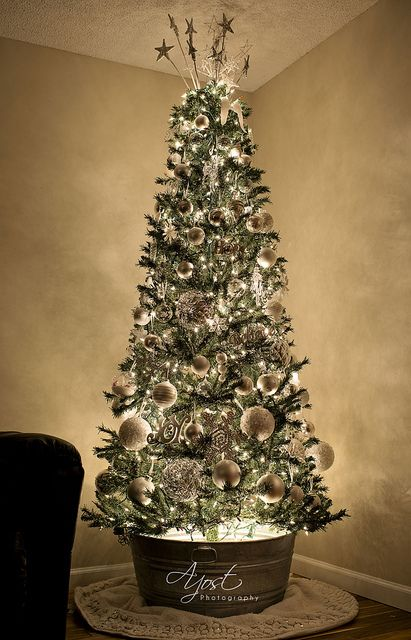 Rustic Christmas tree and it has a light in the galvanized steel tub to light from beneath too. Looks like it's backlit also, how beautiful!: