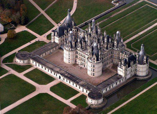 An aerial view of Chateau de Chambord ~ The chateau consists of a massive keep in the center with four enormous towers at the corners, has 365 fireplaces, 84 staircases, and 440 rooms on a 13,000-acre wooded park in Loire Valley.