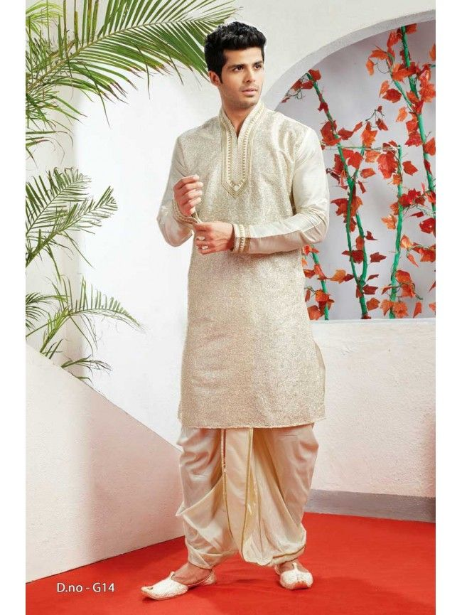 Beige Kurta with Dhoti Mens Wear A dhoti or a veshti is loose fabric that can be draped in several ways to dress a man. It is a timeless and comfortable choice that is suitable and appropriate for weddings all over India. It can be worn simply with a button-down western shirt, a polo teeshirt or a Kurta
