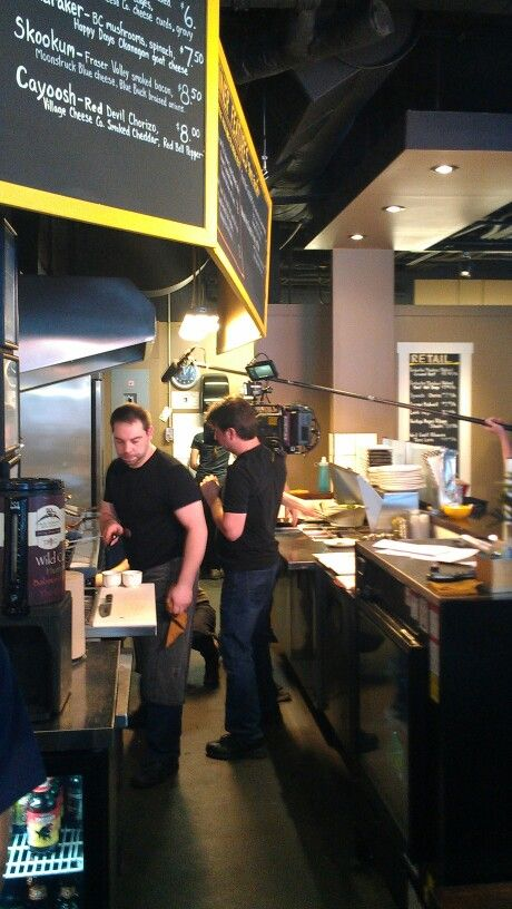 """Mile One Eating House Chef /Owner Randy Jones being filmed """"You Gotta Eat Here!"""" for Food Network Canada, in Pemberton Gateway Village Suites Hotel"""