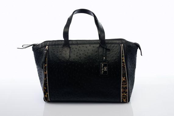 The black leather and leopard print Nova Harley Milan changing bag! Shop at LollipopLane.co.uk for the full range! #changingbag #babybag