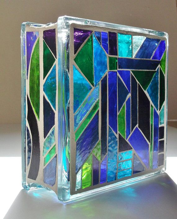 A brilliant stained glass light to enjoy in two different patterns. Done in shades of greens, blues, purples, and a pale green textured glass. The colors in the sunlight are more realistic than the photo with the lights in it. It really is green and not yellow as it looks at times in