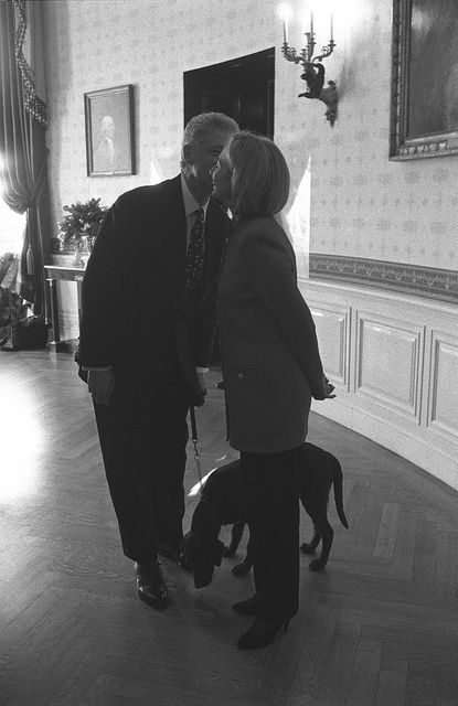 President William Jefferson Clinton and First Lady Hillary Rodham Clinton with Buddy the Dog.  ~ 12/18/1997  |  The U.S. National Archive