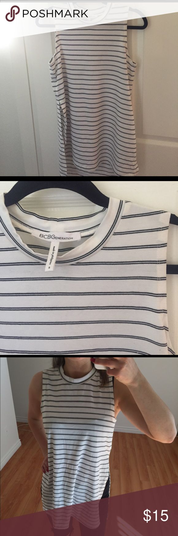BCBG generation white striped tank White mock-turtleneck striped BCBGeneration tank top. Size small. This is a long tank with a high slit in the side! It's perfect for transitioning into spring/summer BCBGeneration Tops Tank Tops