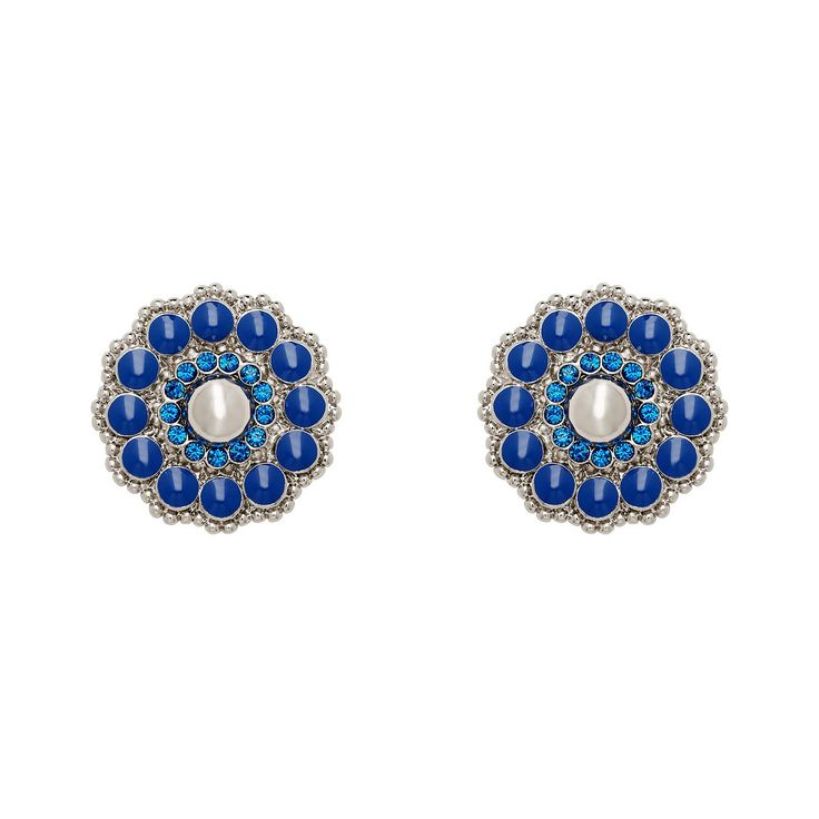 Romantic notion. Crystals and lustrous brass metal combines with elegant enamel work to create a stud with art deco appeal.