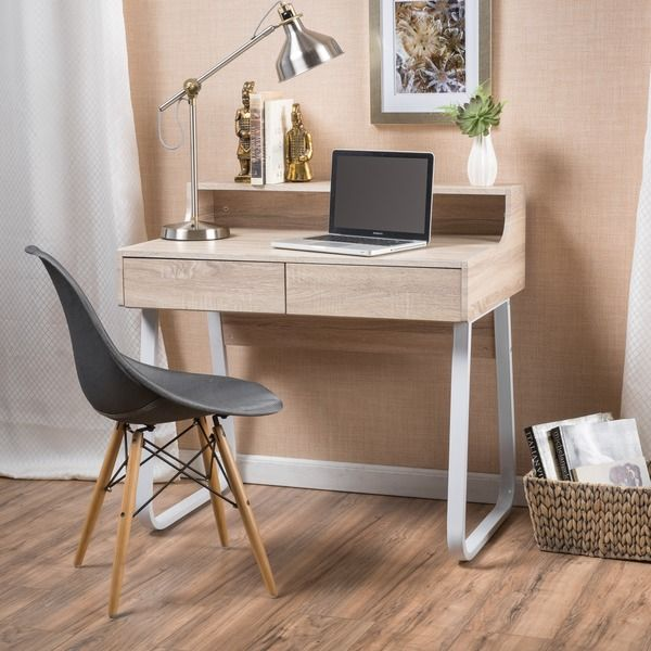 The Christopher Knight Home Seanan is the perfect working desk, providing both style and ease of use. With a ledge to put your computer screen on, and an open back, it becomes the perfect place to sto