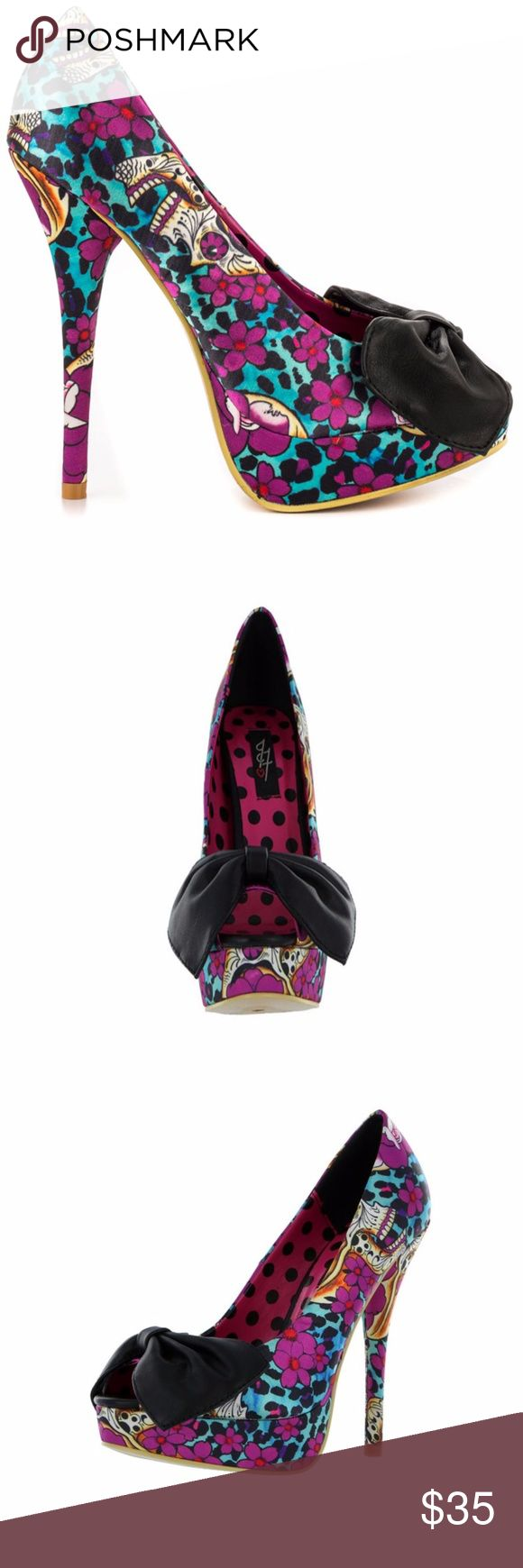 Iron Fist Kisumu Peep Toe Platform Kiss boring fashion goodbye in the Kisumu by Iron Fist. Stand out with the colorful printed fabric upper, 5 1/2 inch heel and 1 inch platform. A large black bow gathers at the front of the peep toe vamp. Brand new, never worn! Iron Fist Shoes Platforms