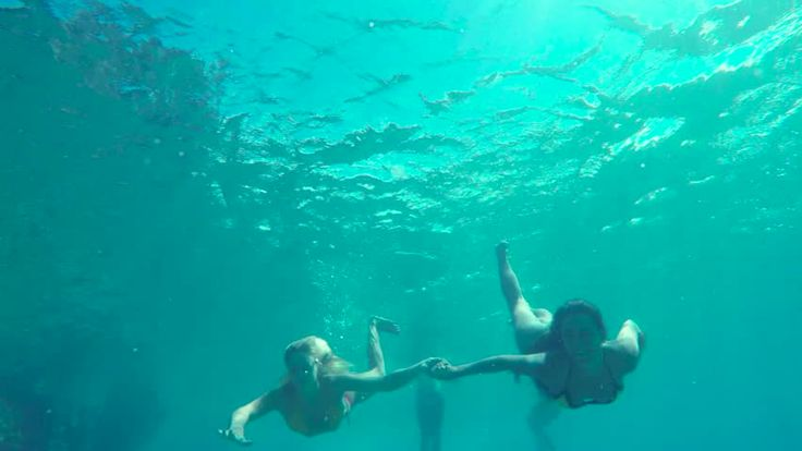 Beautiful Girls in Bikinis Swimming Underwater Holding Hands in Pacific Ocean. Hawaiian Ethnic Girl with Young Blonde Girl Friend. Summer Fun Lifestyle. - HD stock video clip