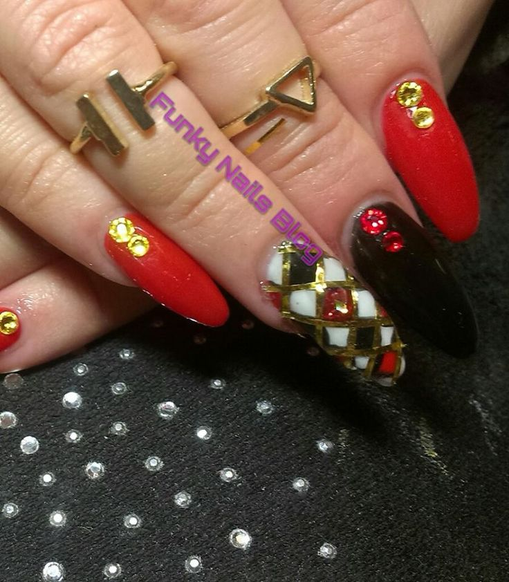 Loved creating these. Lots of different techniques. Free hand nail art. Liquid gems. Gold foil. Halloween Harlequin nails. #halloween #harlequin #gelnails #black #red #white #liquid #gems #swarovkski #diamonds #gold #foil  Connect with me on Facebook https://www.facebook.com/funkynailsgel/