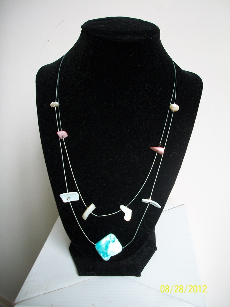 Double strand wire necklace with suspended blue and pink shells and beads - $18