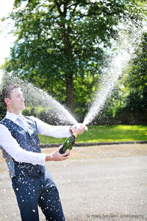 The groom gets soaked in champagne wedding photography ireland longford