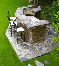 cuisine extérieure avec barbecue construite en pierres