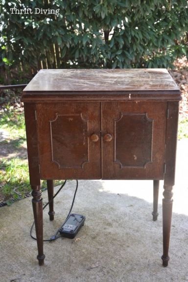 I had found this vintage sewing machine and cabinet at the thrift store for about $80. Although the cord was frayed, I bought it anyhow, and I love the way it turned out! This is the BEFORE. See the after and details in the post. It looks so cute now!