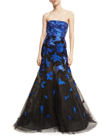 Oscar de la Renta's Gown in Tonal Blue and Black Tulle with Stamped Lace. It has a Straight, Strapless Top-Line and a Fully Structured Bodice. The Skirt has a Layered Fit & Flare Silhouette that Brushes the Floor. Wear it with a Chunky Sapphire & Diamond Necklace, Earrings and an Awesome Ring. I've got Black Satin, Slingback Sandals and a Black Satin Quilted Clutch (It's all on this board). This is Memorably Different. - Gabrielle