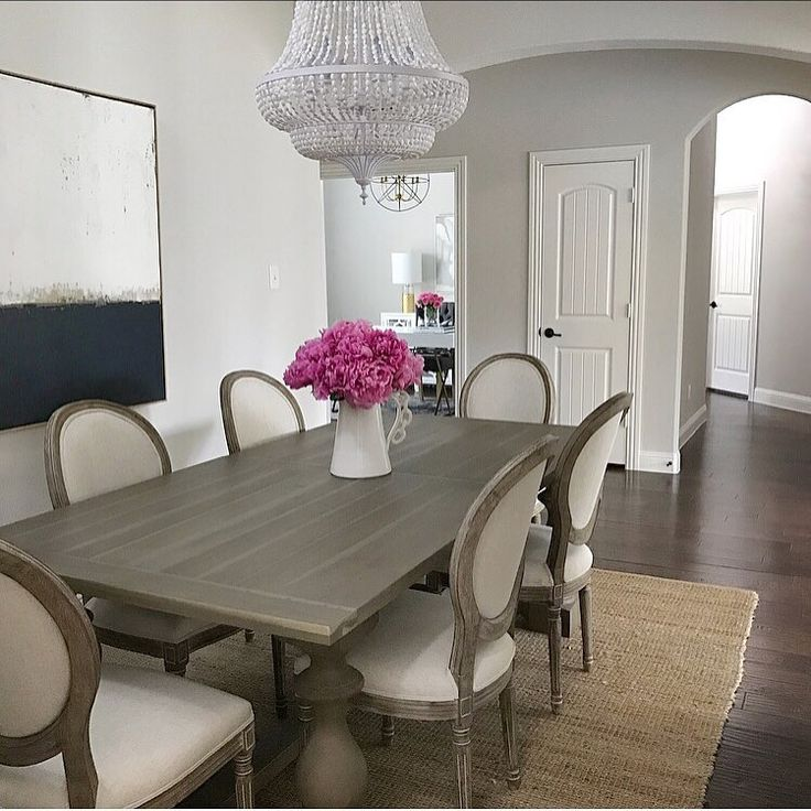 Dining room inspo, classic gray Benjamin Moore paint, restoration hardware dining table 17th century monastery grey acacia, Louis chairs, jute rug, white chandelier, abstract art, pink peonies, interior design, neutral decor, transitional dining room  (@t
