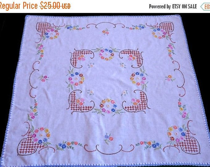 lovely vintage white table cloth with a beautiful embroidery - cross stitch - flowers It looks lovely ! In good vintage condition, couple of tiny spots and one pinhole - look at the last 2 photos Approx. measurements: 30,5 x 31,9 ( 77,5 x 81 cm) .............♥Please convo me if you have any questions♥..............    if you want to purchase more than one item please let us know, we will prepare a special listing for you to lower the shipping costs.
