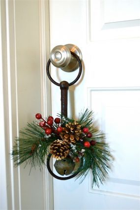 Unique holiday door hanger using an old bell & horse bit - I have some old workhorse bits - I can't wait to decorate them!