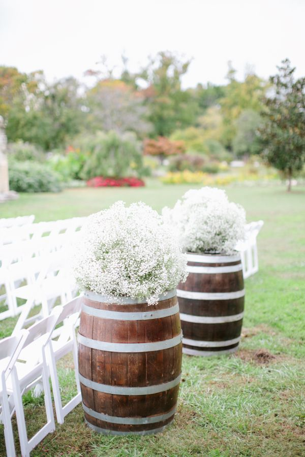 Babys Breath Wine Barrel Wedding Decor / http://www.deerpearlflowers.com/rustic-budget-friendly-gypsophila-babys-breath-wedding-ideas/4/