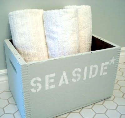 DIY: old wooden bin, painted and perfect for storing beach supplies!