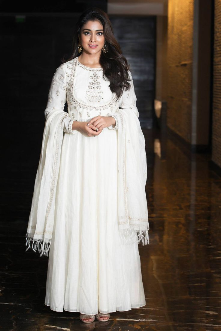 Gorgeous Shriya Saran in white color floor length anarkali dress for Gayatri pre release funtion at Park Hyatt Hyderabad.  28 January 2018