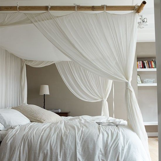 Neutral bedroom with white curtains around bed  How elegant does this bed look? We love its floaty, romantic style. The delicate curtains really spice up this all-white room and make it special. Re-create the look of a grand four-poster by suspending wooden rails from the ceiling and attaching sheer white curtains. It won't cost much, but you'll feel like a princess when you wake up in the morning.  Similar voile curtains Wilko